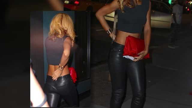 News video: Rihanna Pulls Up Her Pants to Avoid a Wardrobe Malfunction